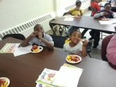 Marcy Newberry kids enjoying a variety of fruits